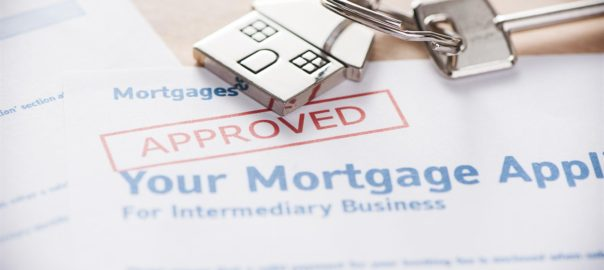 Approved mortgage loan with house key